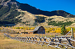 Park County, MT: Wood fence line and barn under the Gallatin Range in fall.