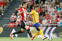 Athletic de Bilbao's Aritz Aduriz (l) and FC Barcelona's Daniel Alves during Supercup of Spain 1st match.August 14,2015. (ALTERPHOTOS/Acero)