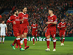 Mohamed Salah and Virgil Van Dijk run to celebrate with scorer Robert Firmino of Liverpool during the Champions League Semi Final 1st Leg match at Anfield Stadium, Liverpool. Picture date: 24th April 2018. Picture credit should read: Simon Bellis/Sportimage