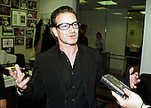 Bono of U2 makes a statement after meeting United States Senator Richard Lugar (Republican of Indiana) in his Capitol Hill office in Washington, D.C. on November 4, 1999 to help promote the Jubilee 2000 campaign to provide debt relief to highly indebted poor countries.  .Credit: Ron Sachs / CNP