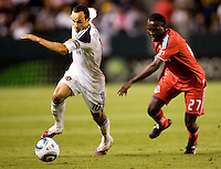 LA Galaxy forward Landon Donovan (10) attempts to move past  Toronto FC midfielder Gabe Gala (27). The LA Galaxy and Toronto FC played to a 0-0 draw at Home Depot Center stadium in Carson, California on Saturday May 15, 2010.  .