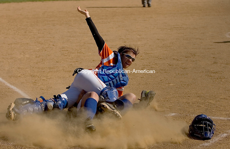 BURLINGTON, CT- MAY 2010-051010JS06-Lewis Mills' Courtney Perzan (1) slides safely into home under the tag of Terryville's Devan Embelton (10) during their game Monday at Lewis Mills High School in Burlington.<br /> Jim Shannon Republican-American