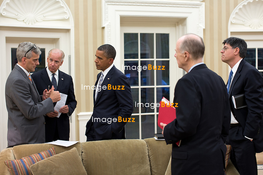 President Barack Obama and Vice President Joe Biden talk with senior advisors in the Oval Office, Sept. 11, 2012. Pictured, from left, are: Deputy National Security Advisor Denis McDonough; National Security Advisor Tom Donilon; and Chief of Staff Jack Lew. (Official White House)..