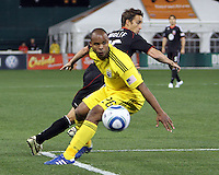 Josh Wolfe#16 of D.C. United turns past Julius James#26 of the Columbus Crew during the opening match of the 2011 season at RFK Stadium, in Washington D.C. on March 19 2011.D.C. United won 3-1.