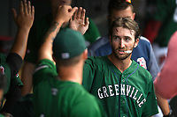 Left fielder Jagger Rusconi (7) of the Greenville Drive is greeted after scoring a run in a game against the Asheville Tourists on Sunday, June 3, 2018, at Fluor Field at the West End in Greenville, South Carolina. Greenville won, 7-6. (Tom Priddy/Four Seam Images)