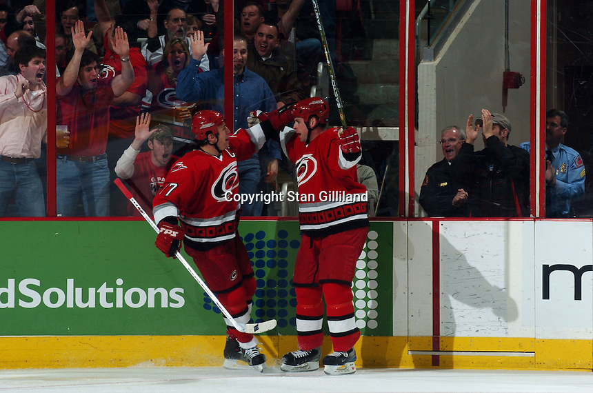 Carolina Hurricanes' Aaron Ward, right, celebrates the first of his two goals against the Boston Bruins with teammate Rod Brind'Amour, left, at the RBC Center in Raleigh, NC Wednesday, March 1, 2006. The Hurricanes won 4-3...