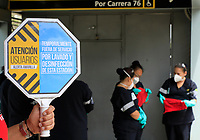 """BOGOTA, COLOMBIA - March 13:  A worker holds a signal informing about the cleaning of a public transportation station  """"Transmilenio"""" on March 13, 2020 in Bogota, Colombia. The World Health Organization declared a global pandemic as the coronavirus rapidly spreads across the world. Colombian President Ivan Duque declared a health emergency to contain an outbreak of coronavirus, suspending public events with more than 500 people. (Photo by John W. Vizcaino/VIEWpress via Getty Images)"""