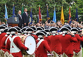 United States President Barack Obama and Mexican President Felipe Calderon watch as the Fife and Drum Corp perform during Calderon's welcoming ceremony on the South Lawn of the White House in Washington on May 19, 2010..Credit: Kevin Dietsch - Pool via CNP
