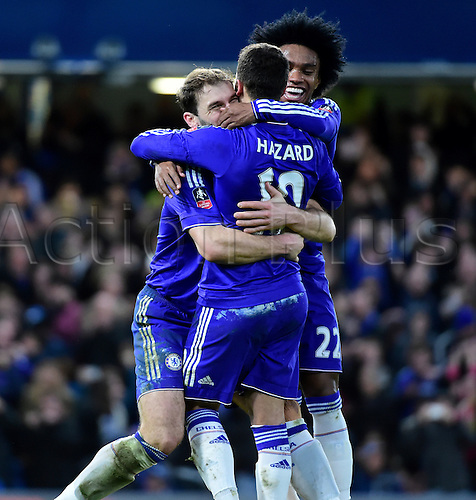 21.02.2016. Stamford Bridge, London, England. Emirates FA Cup 5th Round. Chelsea versus Manchester City. Chelsea's Eden Hazard is congratulated on his goal by Willian and Chelsea's Branislav Ivanovic