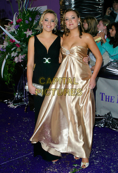 CASSIE & CONNIE POWNEY.Arrivals at the Brithish Soap Awards,.BBC Television Centre, London, England,.May 20th 2006..full length twins sisters hollyoaks strapless satin gold dress black.REf: AH.www.capitalpictures.com.sales@capitalpictures.com.©Adam Houghton/Capital Pictures.