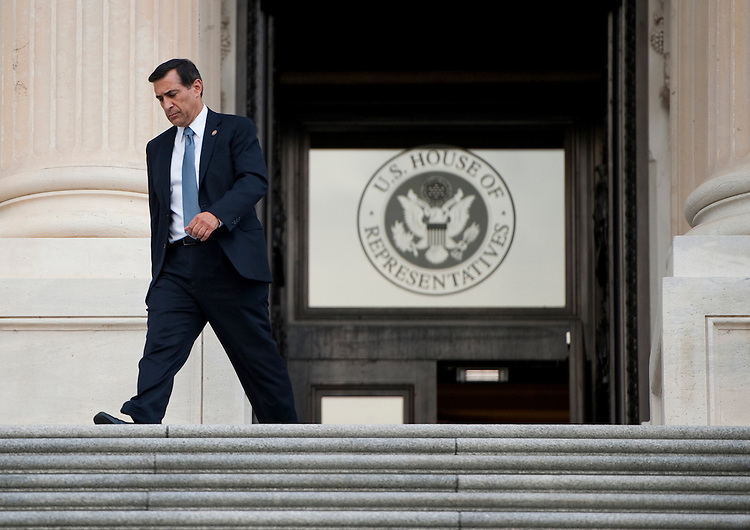 UNITED STATES - AUGUST 1: Rep. Darrell Issa, R-Calif., walks down the House steps of the Capitol after casting his vote on the debt ceiling bill in the House of Representatives on Monday, Aug. 1, 2011. (Photo By Bill Clark/Roll Call)