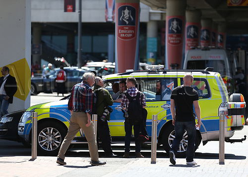 May 27th 2017, Wembley Stadium, London England;  FA Cup Final, Arsenal versus Chelsea FC; Police officers in patrol cars stop members of the press for identification outside Wembley Stadium before kick off