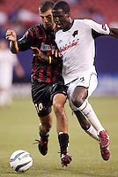 The MetroStars' Kenny Arena battles the Burn's Eddie Johnson for the ball. The Dallas Burn defeated the MetroStars 1-0 at Giant's Stadium, East Rutherford, NJ, on August 15, 2004.