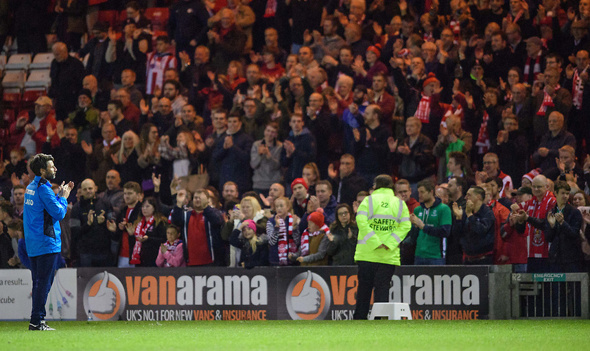 Lincoln City manager Danny Cowley applauds the fans at the end of the game<br /> <br /> Photographer Chris Vaughan/CameraSport<br /> <br /> Vanarama National League - Lincoln City v Chester - Tuesday 11th April 2017 - Sincil Bank - Lincoln<br /> <br /> World Copyright &copy; 2017 CameraSport. All rights reserved. 43 Linden Ave. Countesthorpe. Leicester. England. LE8 5PG - Tel: +44 (0) 116 277 4147 - admin@camerasport.com - www.camerasport.com