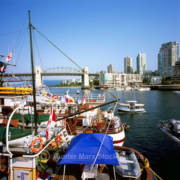 Vancouver, BC, British Columbia, Canada - Historic Wooden Boats docked in False Creek at Granville Island - Burrard Street Bridge in background