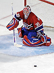 16 January 2007: Montreal Canadiens goaltender Cristobal Huet of France makes a save facing the Vancouver Canucks at the Bell Centre in Montreal, Canada. The Canucks defeated the Canadiens 4-0.Mandatory Credit: Ed Wolfstein Photo *** Editorial Sales through Icon Sports Media *** www.iconsportsmedia.com