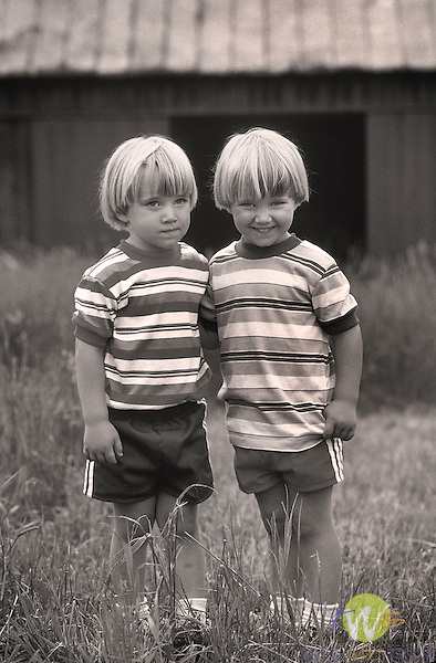 Twin boys in front of barn, Lycoming County, PA. R#1504 1996 4 years old. Ingram