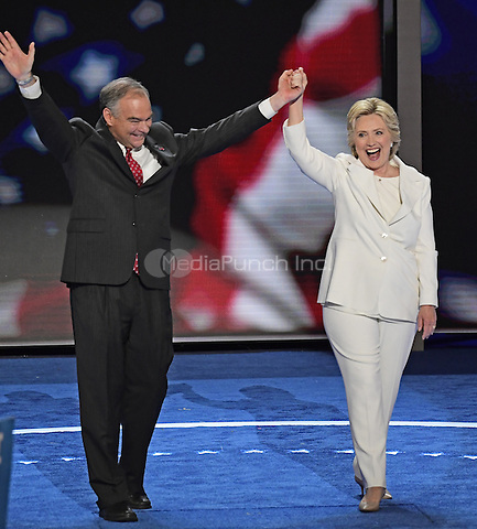 United States Senator Tim Kaine (Democrat of Virginia) and Hillary Clinton, the Democratic Party nominee for President and Vice President of the United States, on the podium after her acceptance speech during the fourth session of the 2016 Democratic National Convention at the Wells Fargo Center in Philadelphia, Pennsylvania on Thursday, July 28, 2016.<br /> Credit: Ron Sachs / CNP/MediaPunch<br /> (RESTRICTION: NO New York or New Jersey Newspapers or newspapers within a 75 mile radius of New York City)