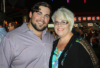"NWA Democrat-Gazette/CARIN SCHOPPMEYER Chris Severio and his mother Dawn Tate attend the ""Greater"" VIP screening Aug. 22. Severio play the role of Brandon Burlsworth in the biographical movie."