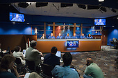 The STS-133 crew members along with Public Affairs Office moderator Nicole Cloutier (left) are pictured during an STS-133 preflight press conference at the National Aeronautics and Space Administration's (NASA) Johnson Space Center in Houston, Texas on Thursday, October 21, 2010.  From the second left are NASA astronauts Steve Lindsey, commander; Eric Boe, pilot; Alvin Drew, Tim Kopra, Michael Barratt and Nicole Stott, all mission specialists.  STS-133, aboard the Space Shuttle Discovery, is scheduled for launch Monday, November 1, 2010 at 4:40 p.m. EDT..Mandatory Credit: James Blair / NASA via CNP.