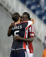 Chivas USA midfielder Shalrie Joseph (18) hugs former teammate New England Revolution defender AJ Soares (5). In a Major League Soccer (MLS) match, the New England Revolution tied Chivas USA, 3-3, at Gillette Stadium on August 29, 2012.