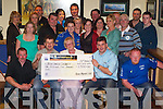 CHARITY: Senan Raggett of the Kerry Motor Club (seated third from left) presenting a cheque for 1,500 to Chris Griffin of the Irish Cancer Society on Friday evening in ORiadas Bar, Ballymac..