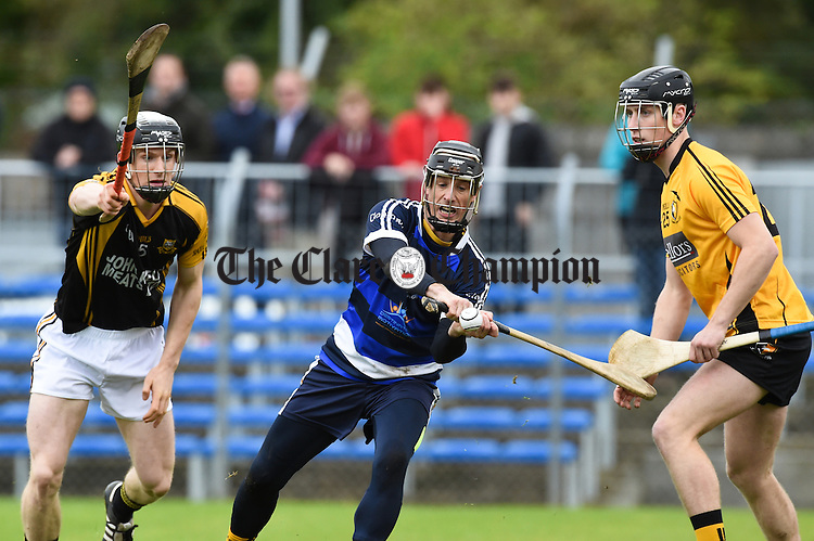 Gearoid O Connell of Ballyea in action against Ger O Connell and Paul Mc Namara of Clonlara during the senior hurling county final at Cusack park. Photograph by John Kelly.