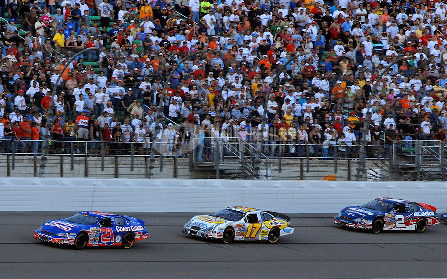 Sept. 30, 2006; Kansas City, KS, USA; Nascar Busch Series driver Kevin Harvick (21) leads Matt Kenseth (17) and Clint Bowyer (2) during the Yellow Transportation 300 at Kansas Speedway. Mandatory Credit: Mark J. Rebilas