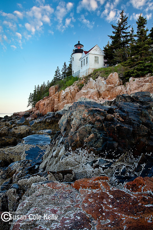 A delicate dawn on Bass Harbor Head Light, on the rocky coast of Maine in Acadia National Park, Downeast, ME, USA