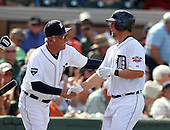 Detroit Tigers catcher Bryan Holaday #76 is congratulated by Jim Leyland #10 after hitting a home run during a exhibition game vs. the Florida Southern Mocs at Joker Marchant Stadium in Lakeland, Florida;  February 25, 2011.  Detroit defeated Florida Southern 17-5.  Photo By Mike Janes/Four Seam Images