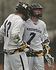 Garrett Gibbons #7 of Massapequa, right, gets congratulated by teammate Logan Tucker #42 after scoring a goal to extend the Chiefs' lead over Farmingdale to 6-4 midway through the fourth quarter of a Nassau County varsity boys lacrosse game at Massapequa High School on Friday, April 27, 2018. Massapequa went on to win by a score of 7-4.