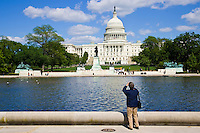 Tourist takesphotograph of The United States Capitol, Washington DC, United States of America