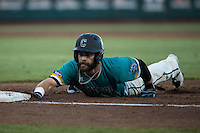 Anthony Marks #29 of the Coastal Carolina Chanticleers slides during a College World Series Finals game between the Coastal Carolina Chanticleers and Arizona Wildcats at TD Ameritrade Park on June 28, 2016 in Omaha, Nebraska. (Brace Hemmelgarn/Four Seam Images)