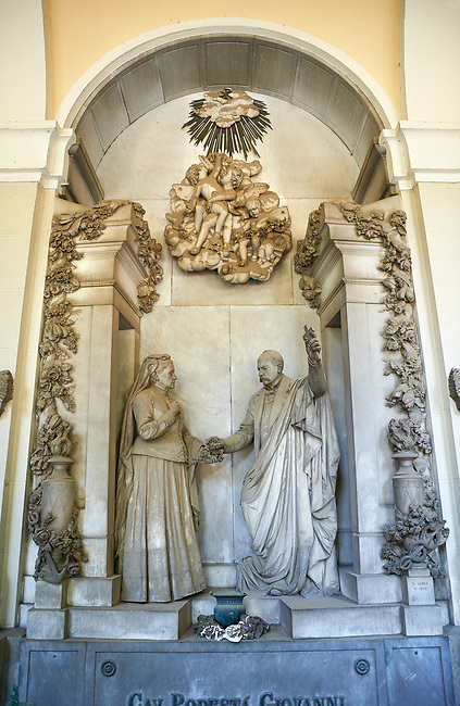 Picture and image of the stone sculpture of the Podesta family tomb in the Borgeois Realistic style by  D Carli 1892. Section A, no 39, The monumental tombs of the Staglieno Monumental Cemetery, Genoa, Italy