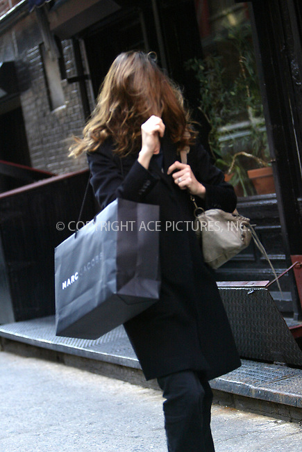 WWW.ACEPIXS.COM . . . . .  ....NEW YORK, OCTOBER 17, 2005....Amanda Peet while shopping in SoHo, with a Marc Jacobs shopping bag under her arm, sees our photographer and immediately pulls her hair down to cover her face. ....Please byline: JENNIFER L GONZELES-ACE PICTURES.... *** ***..Ace Pictures, Inc:  ..Craig Ashby (212) 243-8787..e-mail: picturedesk@acepixs.com..web: http://www.acepixs.com