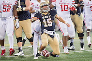 Annapolis, MD - OCT 8, 2016: Navy Midshipmen quarterback Will Worth (15) is fired up after a first down during game between Houston and Navy at Navy-Marine Corps Memorial Stadium Annapolis, MD. The Midshipmen upset #6 Houston 46-40. (Photo by Phil Peters/Media Images International)