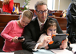 Nevada Sen. Scott Hammond, R-Las Vegas, plays with his daughters Sofia, 7, and Isabella, 3, before opening day ceremonies at the Legislative Building in Carson City, Nev., on Monday, Feb. 2, 2015. (Cathleen Allison/Las Vegas Review-Journal)