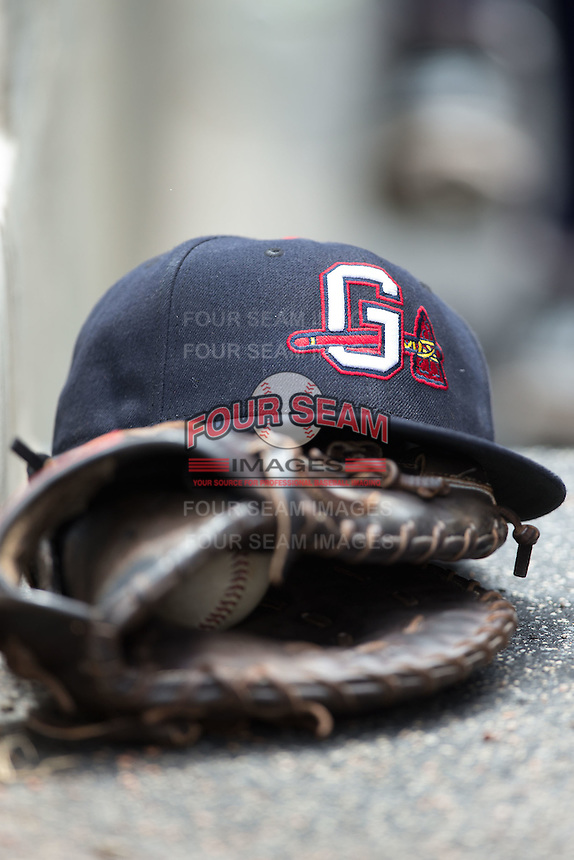 A Gwinnett Braves cap sits on top of a glove in the visitors dugout during the game against the Charlotte Knights at BB&T BallPark on July 3, 2015 in Charlotte, North Carolina.  The Braves defeated the Knights 11-4 in game one of a day-night double header.  (Brian Westerholt/Four Seam Images)