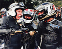 "During a racemeeting at Goodwood in 1993, dozens of legendary riders rode on restored racing machines..Arai provided them with modern helmets: the safety was anything but ""classic""! From left to right: John Surtees, Freddie Spencer and Barry Sheene."