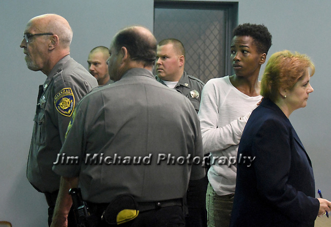 Shyhiem Adams is quickly surrounded by court marshals as they look towards the screaming coming from some of the friends of Justin Brady in the packed courtroom during arraignment in Enfield Superior Court on charges in the stabbing death of 16-year-old of Justin Brady, Tuesday, Sept. 11, 2018, in Enfield, Conn. (Jim Michaud/Journal Inquirer via AP, Pool)