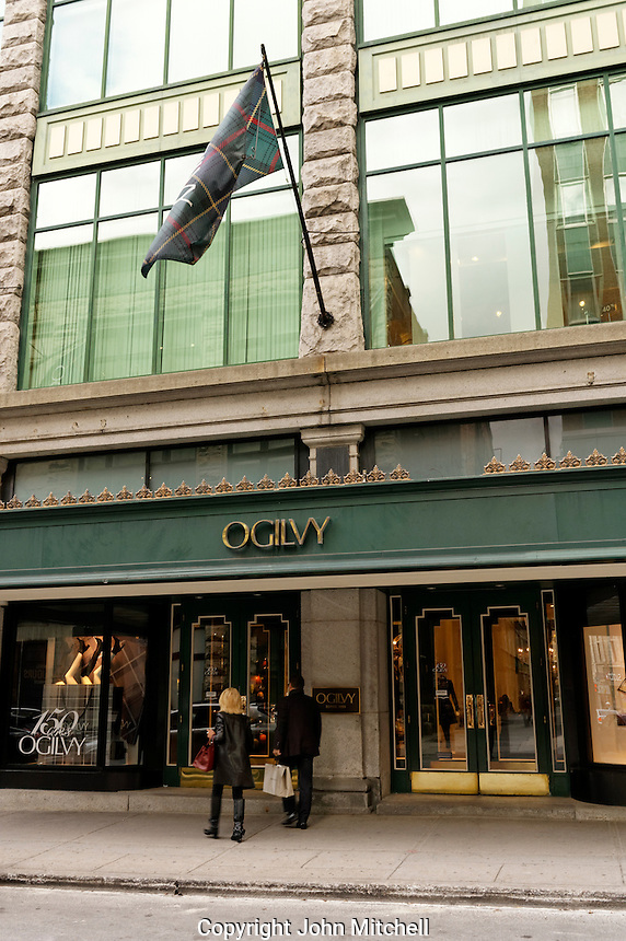 Man and woman entering historic Ogilvy department store in downtown Montreal, Quebec, Canada