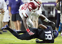 NWA Democrat-Gazette/JASON IVESTER<br /> Arkansas sophomore running back Rawleigh Williams tries to avoid a tackle from TCU junior safety Nick Orr on Saturday, Sept. 10, 2016, during the fourth quarter at Amon G. Carter Stadium in Fort Worth, Texas.