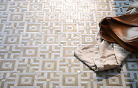 Laberinto, a handmade mosaic shown in honed Calacatta and honed Jura Grey. Designed by Paul Schatz for New Ravenna.<br />