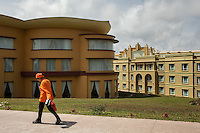 April 18, 2013 - Bokor Mountain, Kampot. An employe of the Bokor casino walks behind the building on top of Bokor Mountain © Nicolas Axelrod / Ruom