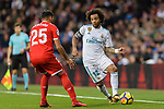 Marcelo da Silva of Real Madrid (R) looks to bring the ball down while being defended by Gabriel Mercado of Sevilla FC (L) during La Liga 2017-18 match between Real Madrid and Sevilla FC at Santiago Bernabeu Stadium on 09 December 2017 in Madrid, Spain. Photo by Diego Souto / Power Sport Images
