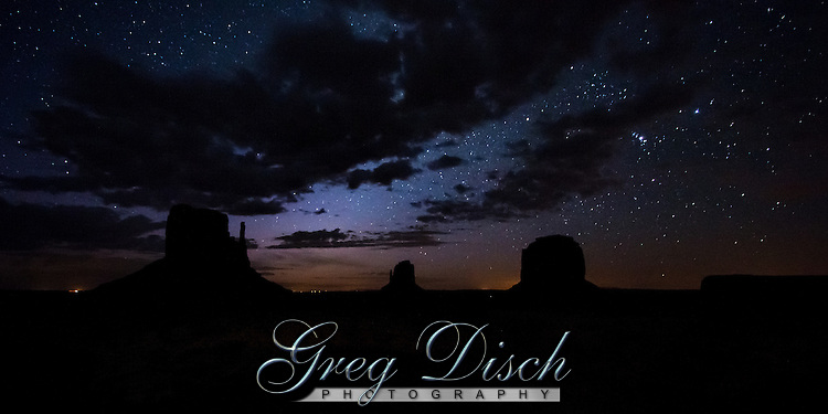 Monument Valley on the Utah and Arizona border is one of the most majestic places on earth. This great valley boasts sandstone masterpieces that tower at heights of 400 to 1,000 feet. framed by scenic clouds casting shadows that graciously roam the desert floor. Monument Valley is a  Navajo Tribal Park and a  frequent a filming location for Western movies.