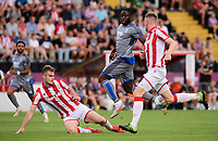 Lincoln City's John Akinde vies for possession with Stoke City's Liam Lindsay, left, and Stoke City's Nathan Collins<br /> <br /> Photographer Chris Vaughan/CameraSport<br /> <br /> Football Pre-Season Friendly - Lincoln City v Stoke City - Wednesday July 24th 2019 - Sincil Bank - Lincoln<br /> <br /> World Copyright © 2019 CameraSport. All rights reserved. 43 Linden Ave. Countesthorpe. Leicester. England. LE8 5PG - Tel: +44 (0) 116 277 4147 - admin@camerasport.com - www.camerasport.com