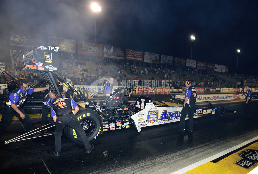 Sept. 28, 2012; Madison, IL, USA: NHRA crew members for top fuel dragster driver Antron Brown during qualifying for the Midwest Nationals at Gateway Motorsports Park. Mandatory Credit: Mark J. Rebilas-