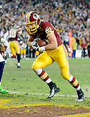 Washington Redskins tight end Logan Paulsen (82) scores a first quarter touchdown against the Seattle Seahawks during an NFC Wild-card play-off game at FedEx Field in Landover, Maryland on Sunday, January 6, 2013.  The Seahawks won the game 24 - 14..Credit: Ron Sachs / CNP