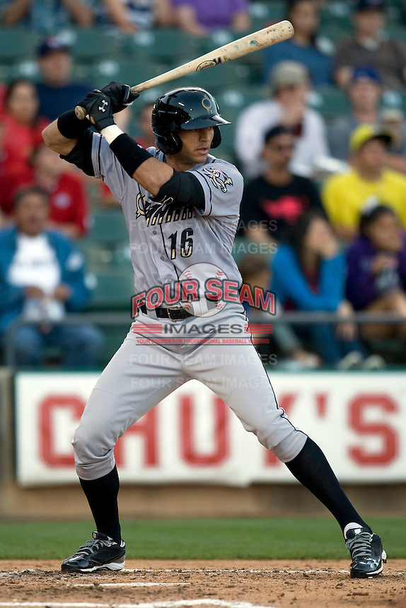 Omaha Storm Chaser outfielder Paulo Orlado at bat against the Round Rock Express in Pacific Coast League baseball on Monday April 11th, 2011 at Dell Diamond in Round Rock Texas.  (Photo by Andrew Woolley / Four Seam Images)nt